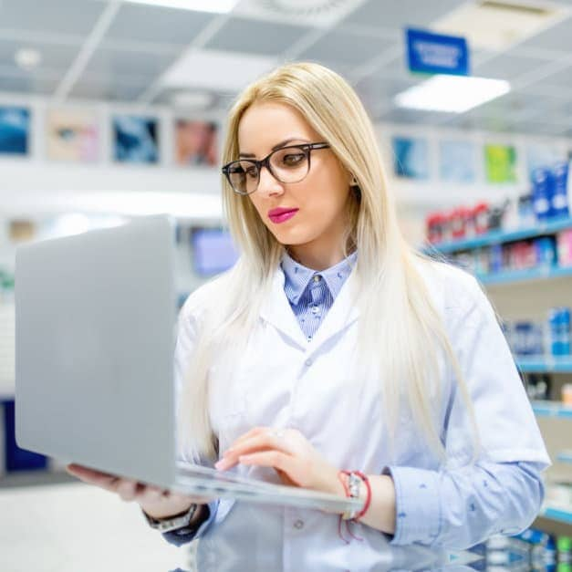 pharmacist with laptop